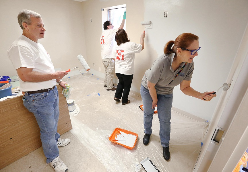 Volunteers refurbishing resident room