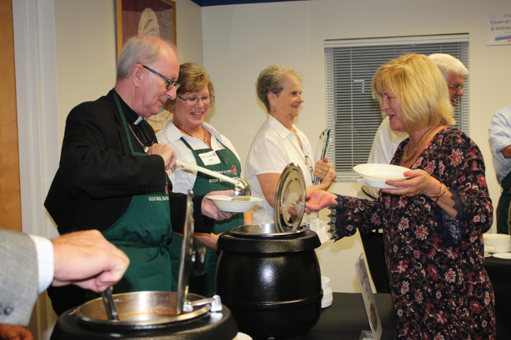 Serving soup at annual Soup Bowl Supper